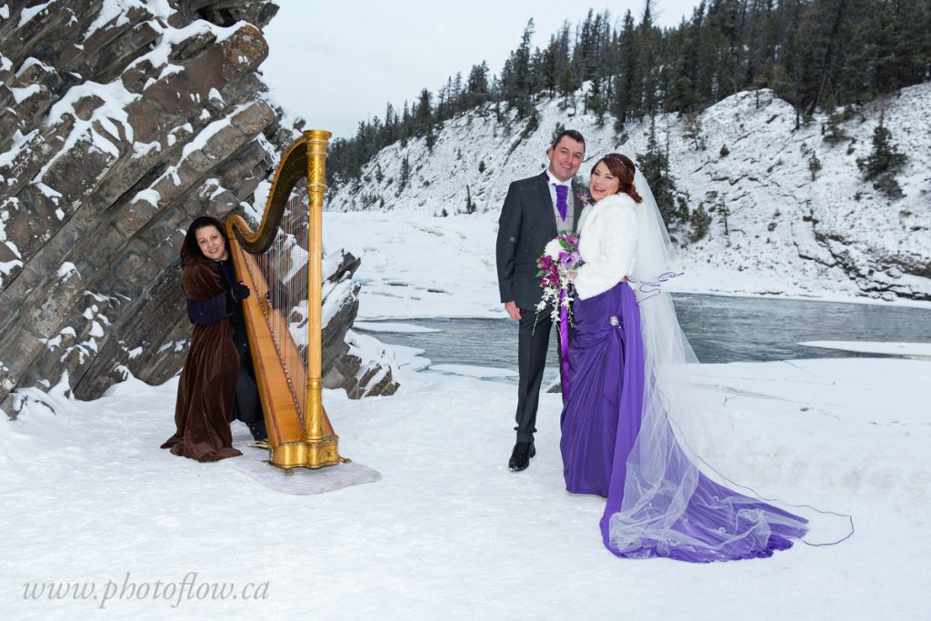 Banff Harpist Harp Angel in a winter snowy wedding